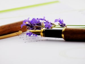 Image shows an attractive fountain pen and paper